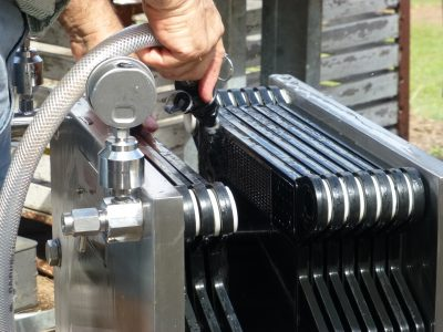 TJ cleaning filters bottling